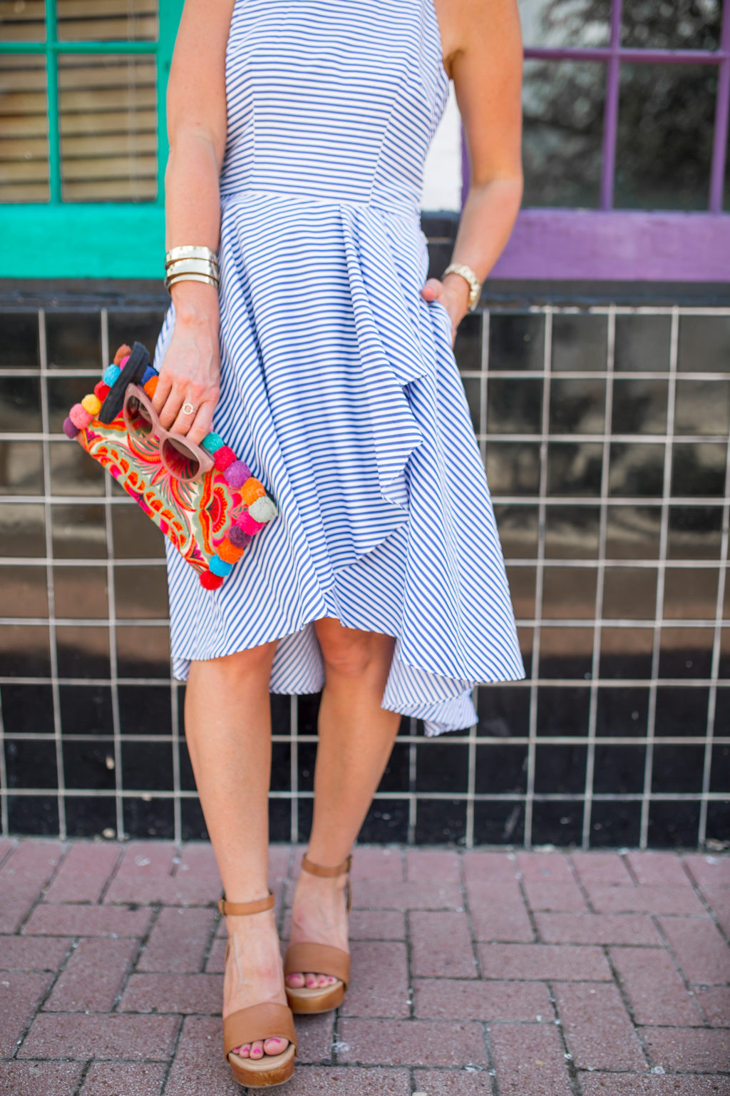 ruffle dress pom pom clutch