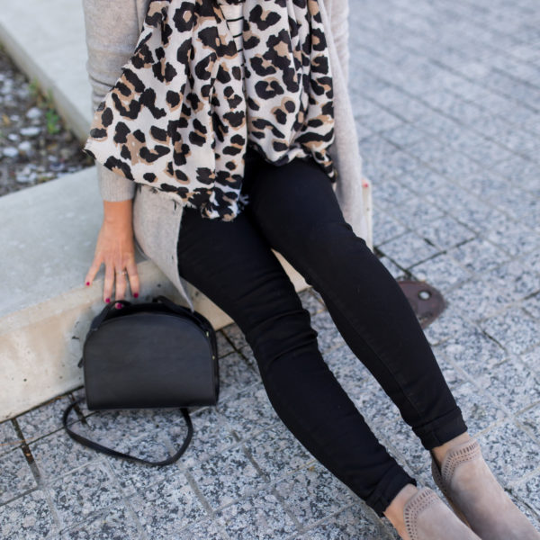 black jeans and taupe booties